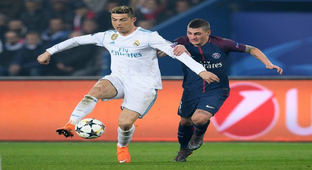 PARIS, FRANCE - MARCH 06: Cristiano Ronaldo of Madrid is challenged by Marco Verratti of Paris during the UEFA Champions League Round of 16 Second Leg match between Paris Saint-Germain and Real Madrid at Parc des Princes on March 6, 2018 in Paris, France. (Photo by Matthias Hangst/Bongarts/Getty Images)