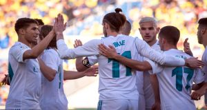 Real Madrid's Welsh forward Gareth Bale (C) celebrates a goal with teammates during the Spanish League football match between UD Las Palmas and Real Madrid CF at the Gran Canaria stadium in Las Palmas on March 31, 2018. / AFP PHOTO / DESIREE MARTIN (Photo credit should read DESIREE MARTIN/AFP/Getty Images)