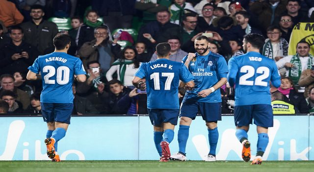 SEVILLE, SPAIN - FEBRUARY 18: Karim Benzema of Real Madrid celebrates after scoring his team's fifth goal during the La Liga match between Real Betis and Real Madrid at Benito Villamrin stadium on February 18, 2018 in Seville, Spain. (Photo by Aitor Alcalde/Getty Images)