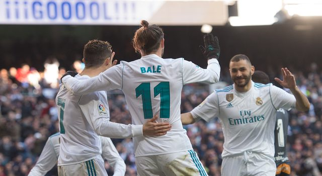 MADRID, SPAIN - FEBRUARY 24: Gareth Bale of Real Madrid celebrates with Karim Benzema after scoring his teamÕs 3rd goal during the La Liga match between Real Madrid and Deportivo Alaves at Estadio Santiago Bernabeu on February 24, 2018 in Madrid, Spain. (Photo by Denis Doyle/Getty Images)