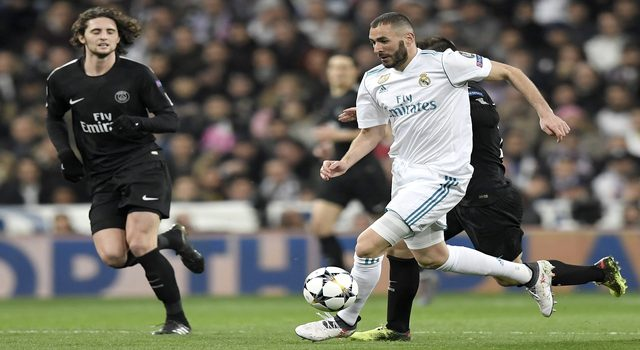 Real Madrid's French forward Karim Benzema (R) vies with Paris Saint-Germain's French midfielder Adrien Rabiot (L) during the UEFA Champions League round of sixteen first leg football match Real Madrid CF against Paris Saint-Germain (PSG) at the Santiago Bernabeu stadium in Madrid on February 14, 2018. / AFP PHOTO / GABRIEL BOUYS (Photo credit should read GABRIEL BOUYS/AFP/Getty Images)