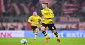 MUNICH, GERMANY - DECEMBER 20: Christian Pulisic of Dortmund plays the ball during the DFB Cup match between Bayern Muenchen and Borussia Dortmund at Allianz Arena on December 20, 2017 in Munich, Germany. (Photo by Sebastian Widmann/Bongarts/Getty Images)