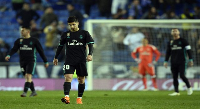 Real Madrid's Spanish midfielder Marco Asensio walks on the field after Espanyol's goal during the Spanish league football match between RCD Espanyol and Real Madrid CF atthe RCDE Stadium in Cornella de Llobregat on February 27, 2018. / AFP PHOTO / Josep LAGO (Photo credit should read JOSEP LAGO/AFP/Getty Images)
